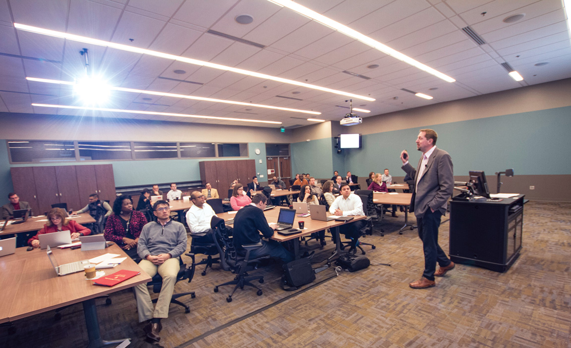 Professor of business economics Kyle Anderson teaches a course to physicians.