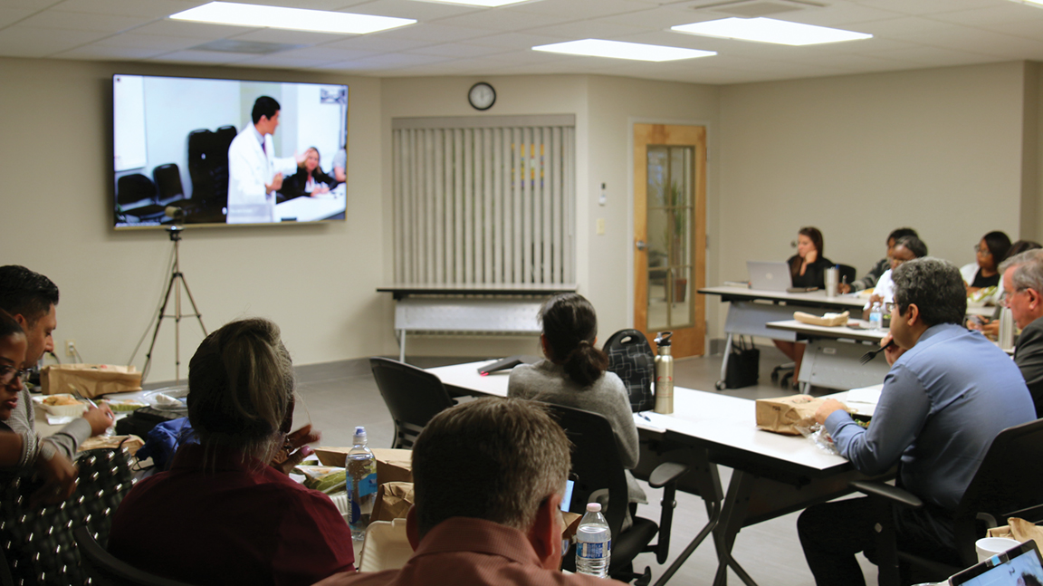 Dr. Gordon Chen addressing doctors via teleconference